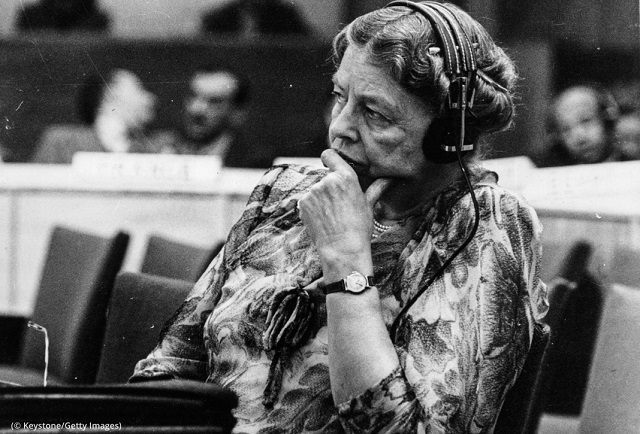 Former U.S. first lady Eleanor Roosevelt listens through headphones during a conference at the temporary U.N. headquarters at Lake Success, New York. Roosevelt chaired the U.N. Human Rights Commission. (© Keystone/Getty Images)