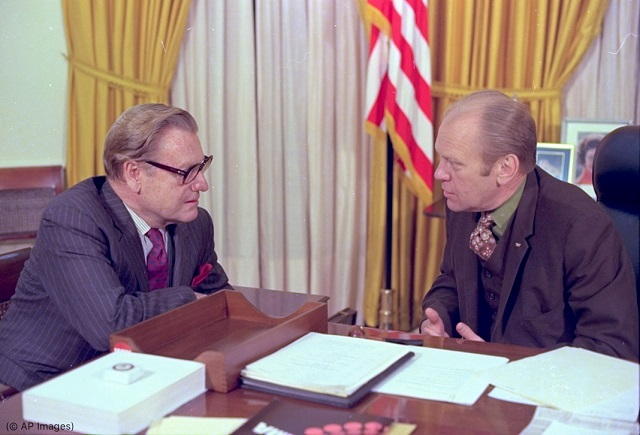 Vice President Nelson Rockefeller, left, and President Gerald Ford confer in the Oval Office in the White House in 1974. (© AP Images)
