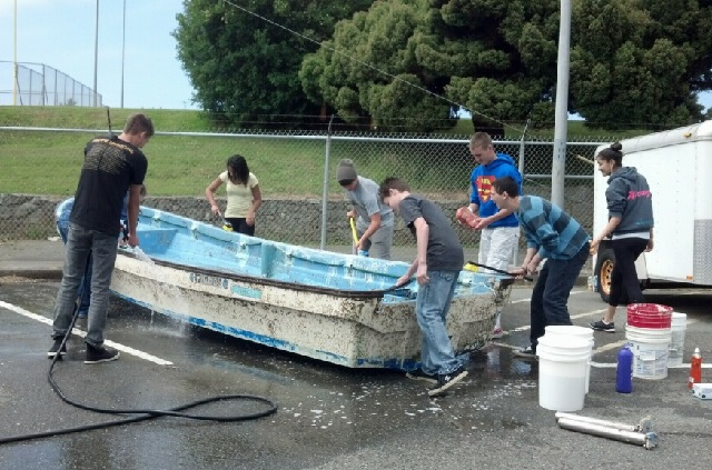 Students at Del Norte High School give Kamome a thorough cleaning before its return journey to Rikuzentakata. (Photo courtesy of Blake Inscore)