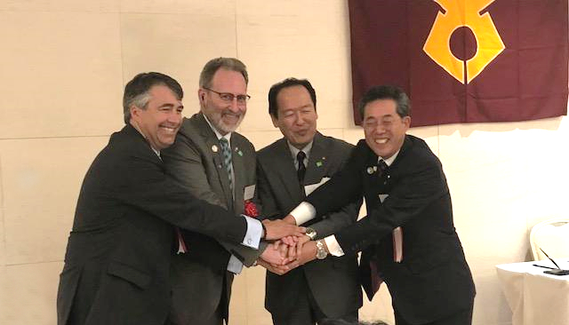 Crescent City Mayor Blake Inscore and Del Norte County Chair Chris Howard seal the sister-city partnership in a handshake with Mayor Futoshi Toba and Chairman Akihiko Ito from Rikuzentakata. (Photo courtesy of Blake Inscore)