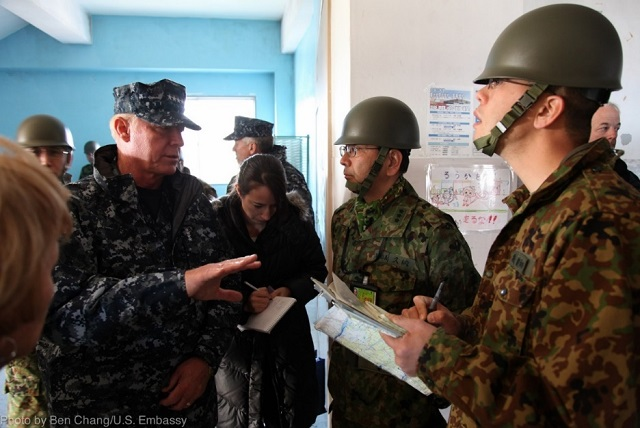 Commander of U.S. Pacific Command, Admiral Robert Willard, meets with Japanese Self-Defense Force officers at a shelter in Miyagi Prefecture, March 23, 2011. (Photo Credit: Ben Chang, U.S. Embassy)