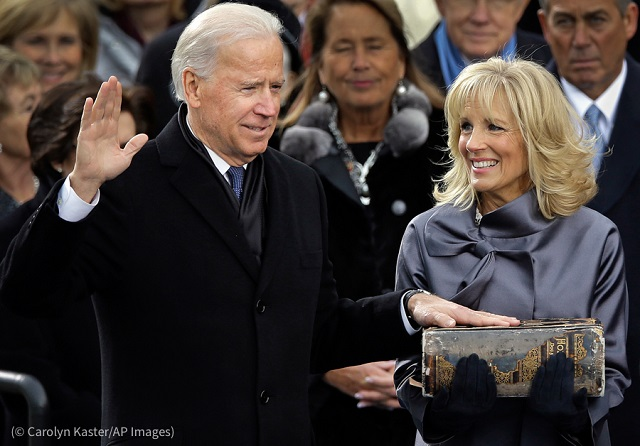 The Bidens have been through something like this before. Here, Jill Biden holds the Bible as her husband is sworn in as U.S. vice president in 2013. (© Carolyn Kaster/AP Images)