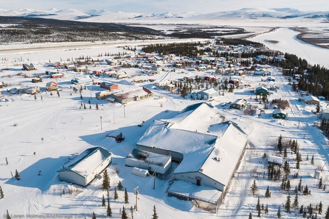 The northwest Alaska village of Kiana is shown March 14, 2019. The school (foreground) and airport are large infrastructure projects supported by the state, which struggles to provide a consistent local law enforcement presence in the community. (© Loren Holmes/Anchorage Daily News)