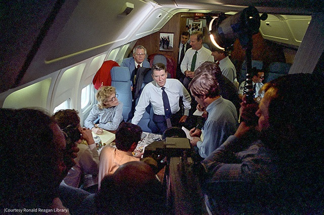 President Ronald Reagan talks to reporters aboard Air Force One. (Courtesy Ronald Reagan Library)