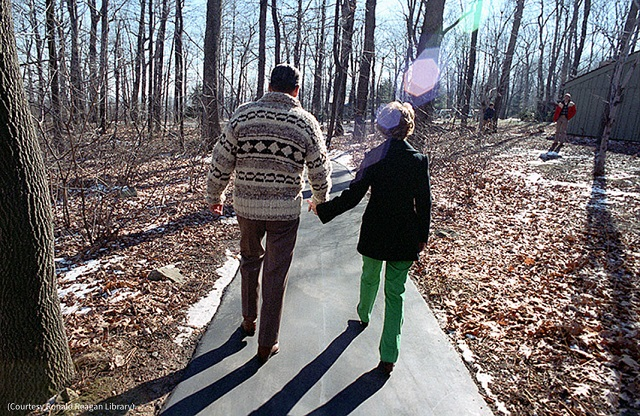 President Ronald Reagan and Nancy Reagan walk together at Camp David in Maryland. (Courtesy Ronald Reagan Library)