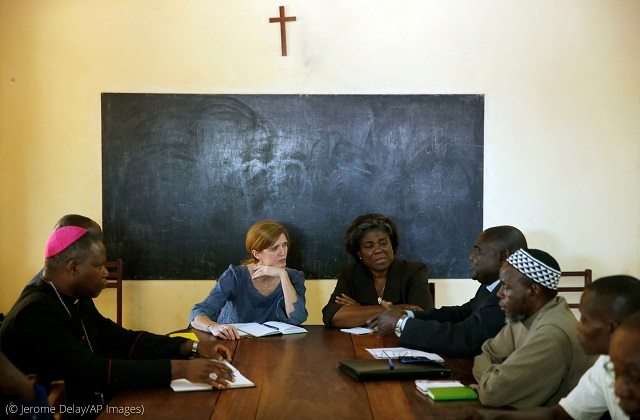Thomas-Greenfield (center right), then assistant secretary of state for African Affairs, and Samantha Power (center left), then U.S. representative to the U.N., meet with Muslim and Christian leaders in Bangui, Central African Republic, in 2013. (© Jerome Delay/AP Images)