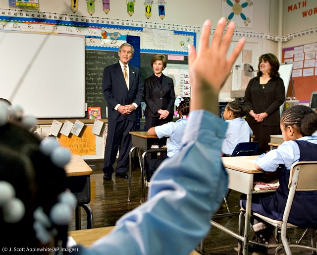 Former President George W. Bush and first lady Laura Bush visit students at the General Philip Kearny School in Philadelphia in 2009. (© J. Scott Applewhite/AP Images)