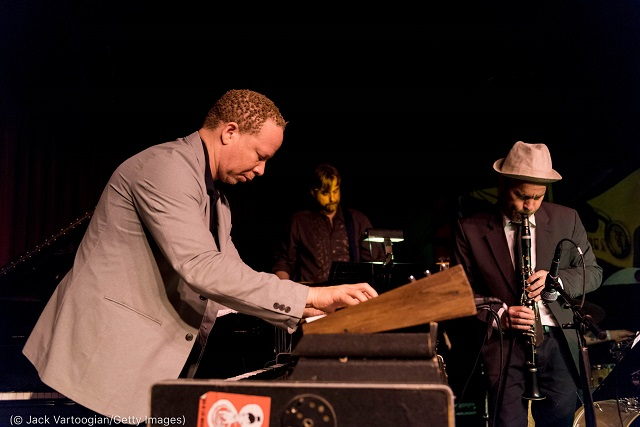 Craig Taborn (left), Chris Lightcap (rear) and Chris Speed perform at the Village Vanguard in New York before the pandemic. (© Jack Vartoogian/Getty Images)