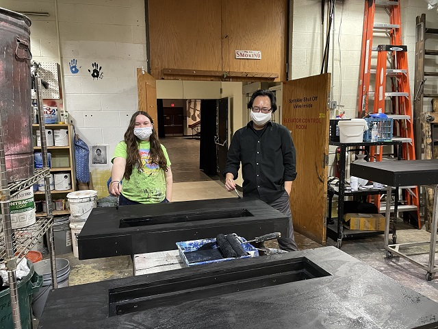Sophia and I painting a piece of the scenery for an upcoming musical at the school.