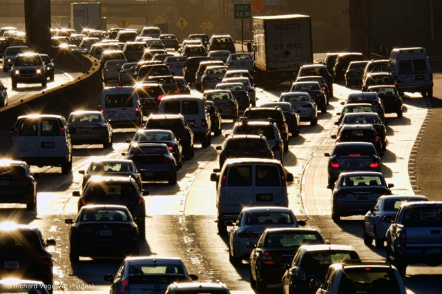 Morning rush hour traffic moves in the southbound lanes along U.S. 101 near downtown Los Angeles in 2016. (© Richard Vogel/AP Images)