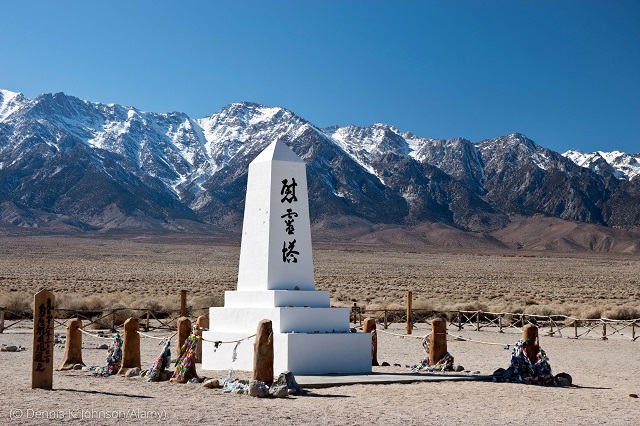 The U.S. government detained 120,000 Japanese Americans during World War II. The Manzanar Cemetery Monument honors 150 of them who died at the Manzanar camp, some of whom are buried nearby. One of its inscriptions says it was erected by the Manzanar Japanese. (© Dennis K. Johnson/Alamy)