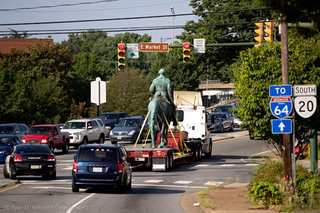 A statue of Confederate General Robert E. Lee is driven away from a park in Charlottesville, Virginia, in July, nearly four years after the threat of its removal attracted a white supremacist mob that turned violent, leaving one woman dead. (© Ryan M. Kelly/AFP/Getty Images)